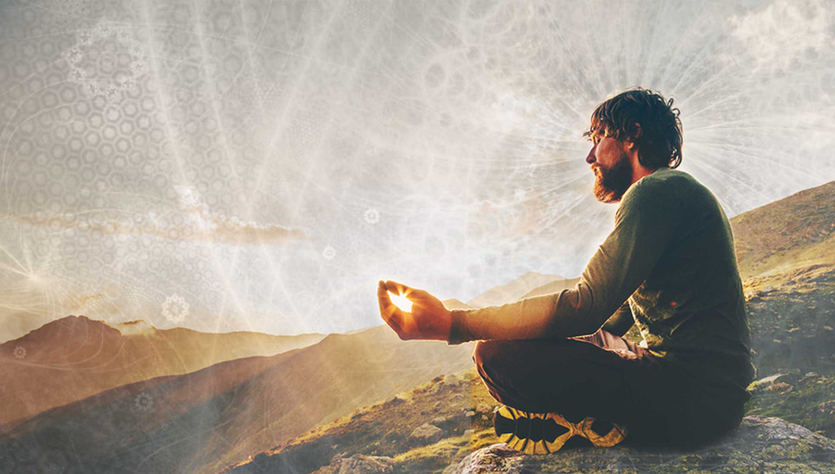 A simple lifestyle - Man meditating on a mountain