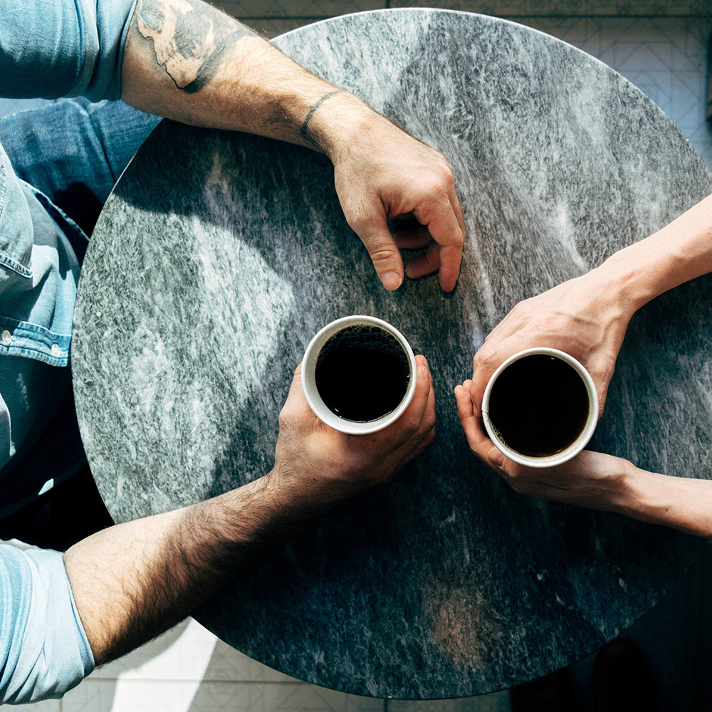 people sharing a cup of coffee